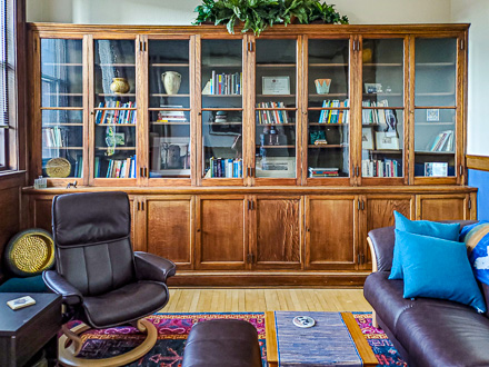 Kathleen Gleeson Counseling Iowa City Therapist psychotherapy loss trauma PTSD EMDR office bookcase